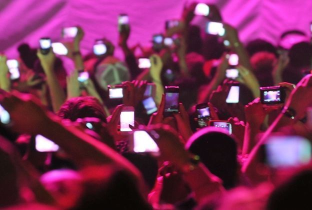 People recording concerts